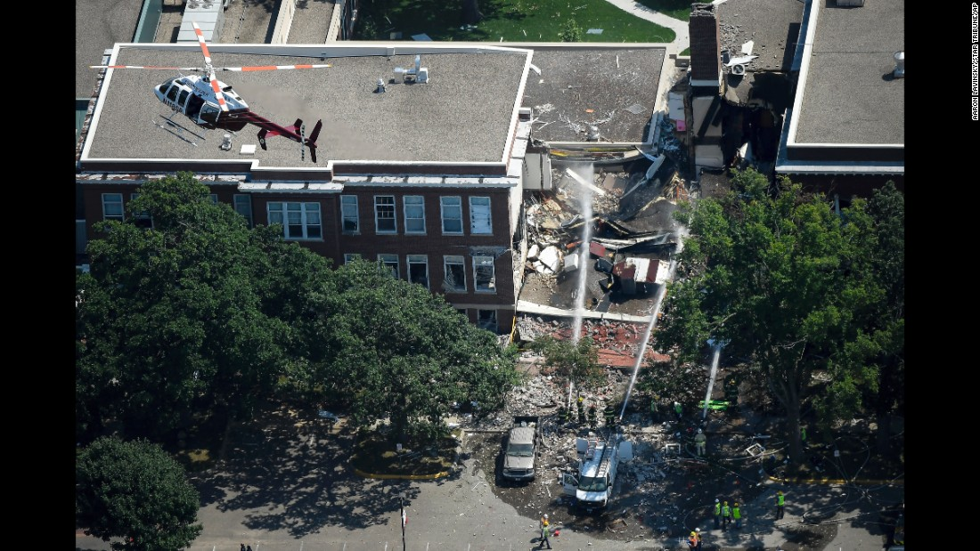 "Emergency workers respond to <a href=""http://www.cnn.com/2017/08/02/us/minneapolis-school-building-collapse-fire/index.html"" target=""_blank"">a natural-gas explosion</a> at Minnehaha Academy, a school in Minneapolis, on Wednesday, August 2. Two people were killed and nine were injured in the blast, which is under investigation."