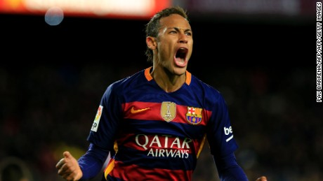 TOPSHOT - Barcelona's Brazilian forward Neymar celebrates after scoring during the Spanish Copa del Rey (King's Cup) round of 16 first leg football match FC Barcelona vs RCD Espanyol at the Camp Nou stadium in Barcelona on January 6, 2016.   AFP PHOTO/ PAU BARRENA / AFP / PAU BARRENA        (Photo credit should read PAU BARRENA/AFP/Getty Images)