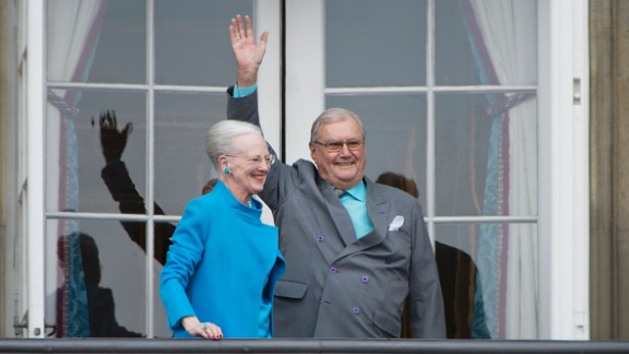 Queen Margrethe and Prince Henrik greet well-wishers from the balcony on the occasion of the Queen's 76th Birthday in April 2016.