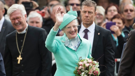 Queen Margrethe II of Denmark waves to well wishers outside the All Saints' church in Wittenberg, eastern Germany, on October 2, 2016.