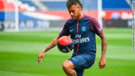 "Brazilian superstar Neymar plays with a ball during his official presentation at the Parc des Princes stadium on August 4, 2017 in Paris after agreeing a five-year contract following his world record 222 million euro ($260 million) transfer from Barcelona to Paris Saint Germain's (PSG). Paris Saint-Germain have signed Brazilian forward Neymar from Barcelona for a world-record transfer fee of 222 million euros (around $264 million), more than doubling the previous record. Neymar said he came to Paris Saint-Germain for a ""bigger challenge"" in his first public comments since arriving in the French capital. / AFP PHOTO / Lionel BONAVENTURE        (Photo credit should read LIONEL BONAVENTURE/AFP/Getty Images)"