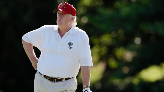 FILE - In this June 27, 2012, file photo, Donald Trump stands on the 14th fairway during a pro-am round of the AT&T National golf tournament at Congressional Country Club in Bethesda, Md. A set of golf clubs that Trump gifted to a former caddie before becoming president is being auctioned off. Boston-based RR Auction says Trump used the TaylorMade RAC TP ForgedIrons clubs at the Trump National Golf Club in Bedminster, New Jersey. (AP Photo/Patrick Semansky, File)