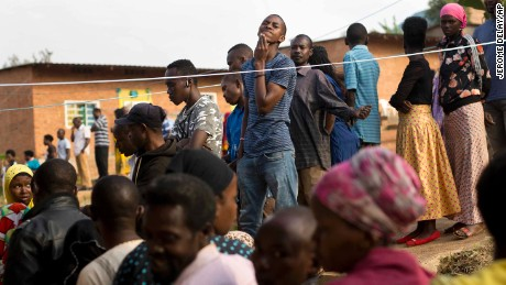 Rwandans line up to vote at a polling station in Rwanda's capital, Kigali, on Friday.