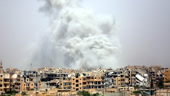Smoke billows out from Raqqa after a coalition airstrike in July.