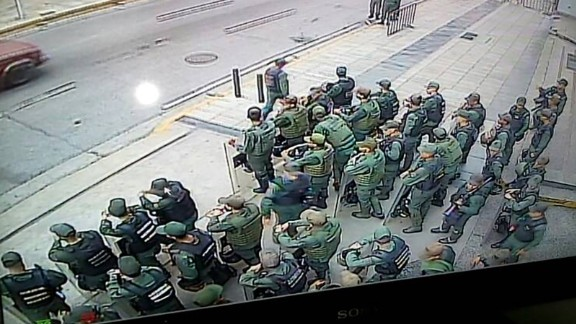 An image distributed by Ortega's press office shows troops outside her office in the capital, Caracas.