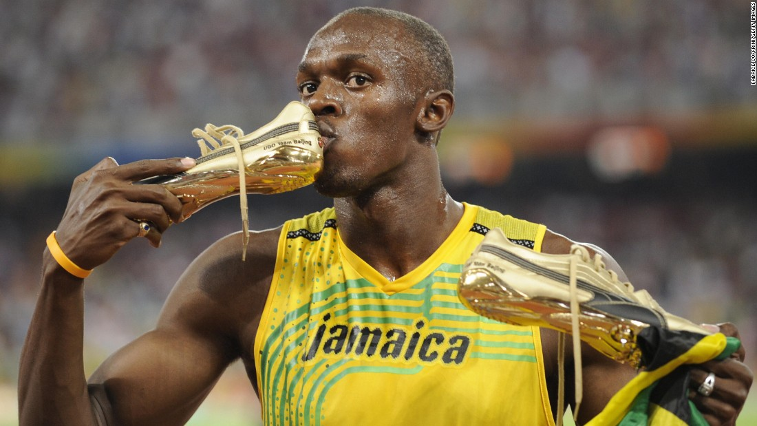 Bolt kisses his shoe after winning the men's 100-meter final at the 2008 Olympic Games. He topped his own world record, finishing in 9.69 seconds.