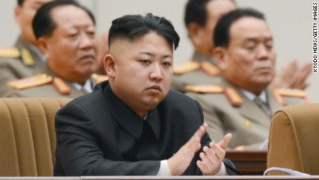 North Korean leader Kim Jong Un (front) claps during a national memorial service in Pyongyang on Dec. 16, 2012, to mark the first anniversary on Dec. 17 of the death of Kim Jong Il, his father and predecessor.