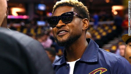 CLEVELAND, OH - JUNE 07: Recording artist Usher attends Game 3 of the 2017 NBA Finals between the Golden State Warriors and the Cleveland Cavaliers at Quicken Loans Arena on June 7, 2017 in Cleveland, Ohio. NOTE TO USER: User expressly acknowledges and agrees that, by downloading and or using this photograph, User is consenting to the terms and conditions of the Getty Images License Agreement.  (Photo by Ronald Martinez/Getty Images)