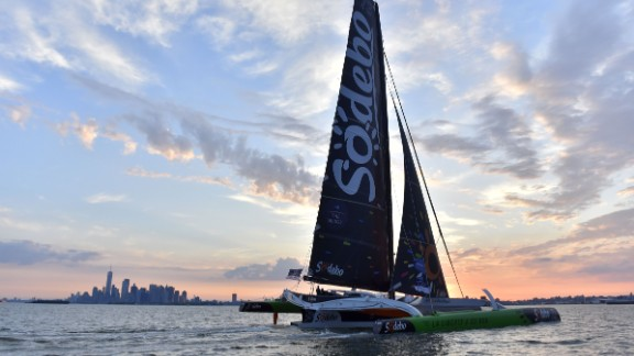 French skipper Thomas Coville sails Sodebo Ultim multihull on July 4, 2017 in New York city after they placed third in The Bridge 2017, a transatlantic race between the cruise liner RMS Queen Mary 2 and the world