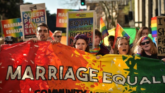 Supporters of same-sex marriage carry banners and shout slogans as they march in Sydney on August 6.