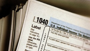 DES PLAINES, IL - MARCH 23: The top of a form 1040 individual income tax return for 2005 is seen atop a stack on the same at the Des Plaines Public Library March 23, 2006 in Des Plaines, Illinois. Americans are preparing for the income tax filing deadline next month whether using tax software, filing on the paper forms or using a tax preparer.  (Photo by Tim Boyle/Getty Images)