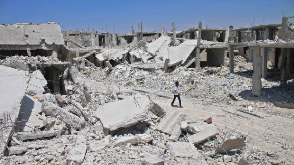 A Syrian man walks down a destroyed street in a rebel-held area in Daraa on July 19, 2017, as civilians started to return to the area following the July 9 agreement ceasefire brokered by the United States, Russia and Jordan creating a de-escalation zone in Syria's southern Daraa, Quneitra and Sweida regions.  / AFP PHOTO / Mohamad ABAZEED        (Photo credit should read MOHAMAD ABAZEED/AFP/Getty Images)