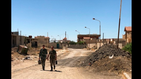 The front line still divides Quneitra, but there is virtually no fighting at the moment, the regime says. Soldiers are relaxed as they go to their battle positions.