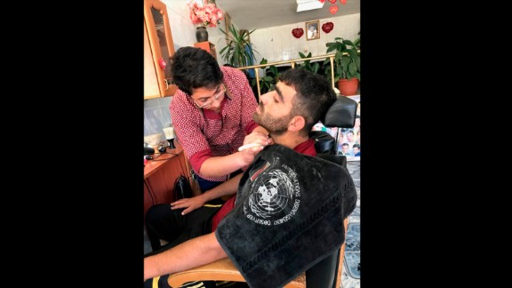 Barber Hadi al Asaad has more customers now. He hopes things will return to the way they were before the crisis with the ceasefire.