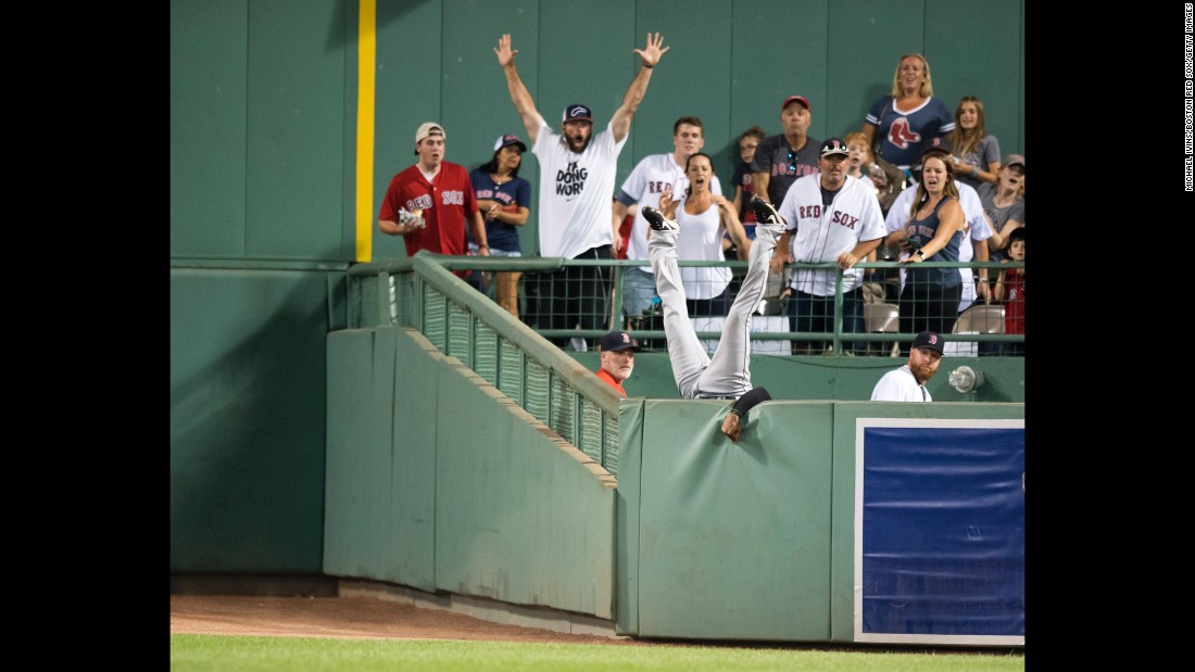 "Cleveland's Austin Jackson leaps over the bullpen wall in Boston to rob Hanley Ramirez of a home run on Tuesday, August 1. <a href=""http://bleacherreport.com/articles/2725176-austin-jackson-flips-over-wall-while-robbing-home-run-at-fenway"" target=""_blank"">See the spectacular catch</a>"