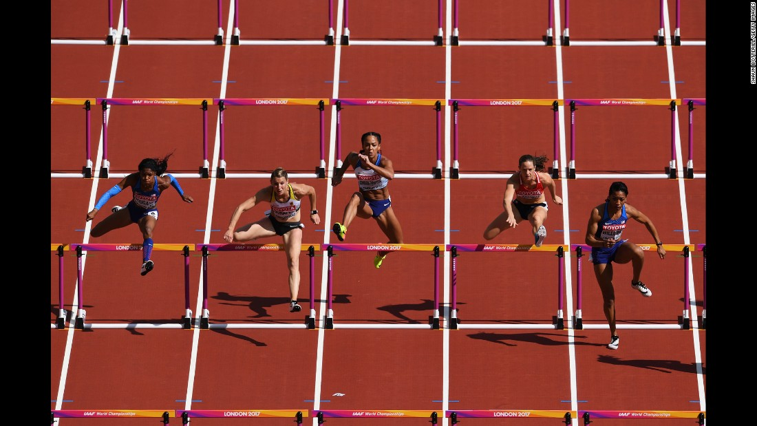 Heptathletes compete in the 100-meter hurdles at the World Championships on Saturday, August 5.