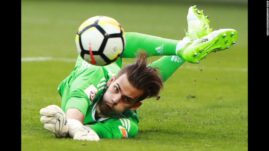 Ilya Pomazun, a goalkeeper for CSKA Moscow, dives for the ball during a Russian Premier League match against Rubin Kazan on Sunday, August 6.
