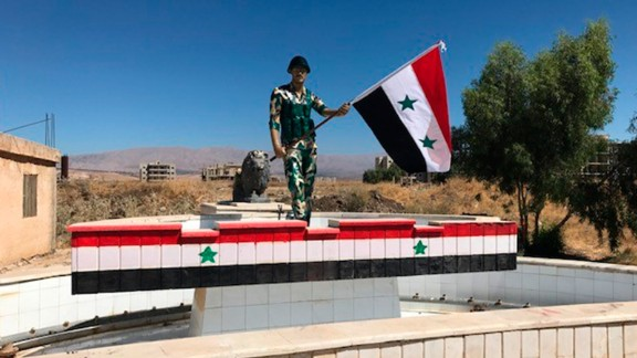 Syrian Army troops decorated this monument to their soldiers. The Golan Heights are in the background.