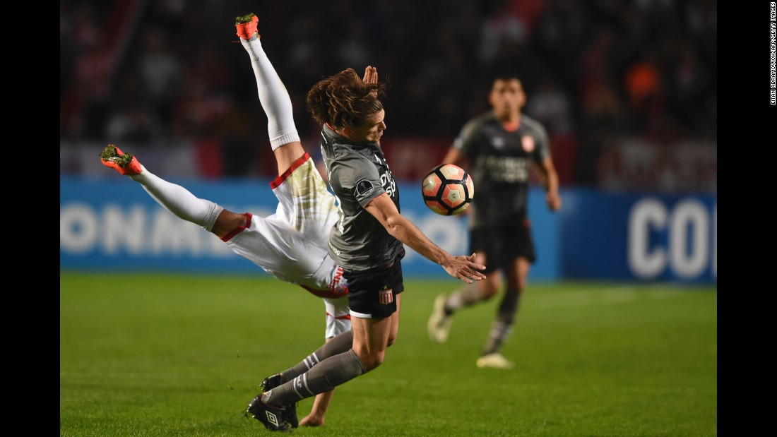 Luis Anibal Torrico, left, collides with Sebastian Dubarbier during a Copa Sudamericana match in La Plata, Argentina, on Thursday, August 3. Dubarbier and his Argentine club, Estudiantes, defeated Bolivian club Nacional Potosi to advance to the tournament's round of 16.