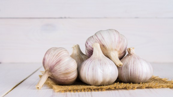 """Garlic is the edible bulb of the lily family and is widely promoted as a health aid for high blood pressure, cancer, cholesterol and the common cold. But the National Center for Complementary and Integrative Health says<a href=""""https://nccih.nih.gov/health/garlic/ataglance.htm"""" target=""""_blank"""" target=""""_blank""""> the research</a> into these claims is inconclusive. The center recommends adding garlic to foods but warns that it can increase the risk of bleeding in those on warfarin or needing surgery and can interfere with some drugs, including one that treats HIV."""