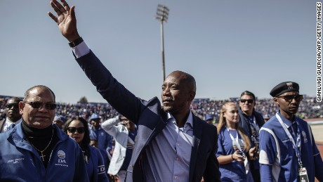 South African main opposition party Democratic Alliance leader Mmusi Maimane gestures as he salutes the crowd during the final Municipal Elections campaign rally at Dobsonville Stadium in Soweto, on July 30, 2016. / AFP / GIANLUIGI GUERCIA        (Photo credit should read GIANLUIGI GUERCIA/AFP/Getty Images)