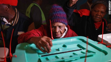 Lydia Gathoni, a Kenyatta supporter, voted just after dawn at a  station north of Nairobi.