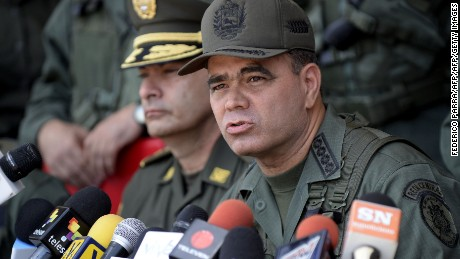 The Commander in Chief of Bolivarian National Armed Forces of Venezuela, Vladimir Padrino, speaks next to Colombia's Brigadier General Gustavo Moreno (L) during a press conference to inform about the creation of a Binational Centre for the Coordination of Operations Against Smuggling, in San Cristobal, Venezuela, on August 11, 2014. Venezuela said Monday it has deployed 17,000 troops along the Colombian border to combat gasoline smuggling, as it prepared to seal the frontier nightly to stanch multi-billion-dollar annual losses. Oil-rich Venezuela has some of the world's cheapest gasoline, as well as price controls that can make food and commodities up to 10 times less expensive than in Colombia. The Venezuelan government estimates that 40 percent of the country's basic commodities are smuggled across the border with Colombia, plus 100,000 barrels of oil, equivalent to annual losses of $3.7 billion. AFP PHOTO/FEDERICO PARRA        (Photo credit should read FEDERICO PARRA/AFP/Getty Images)