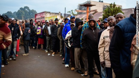 Kenyans wait in line to cast their ballot in the general elections at a polling station in the Rift Valley town of Eldoret on August 8, 2017. Kenyans began voting on August 8 in general elections headlined by a too-close-to-call battle between incumbent Uhuru Kenyatta and his rival Raila Odinga, sparking fears of violence in east Africa's richest economy. / AFP PHOTO / Jennifer HUXTA        (Photo credit should read JENNIFER HUXTA/AFP/Getty Images)