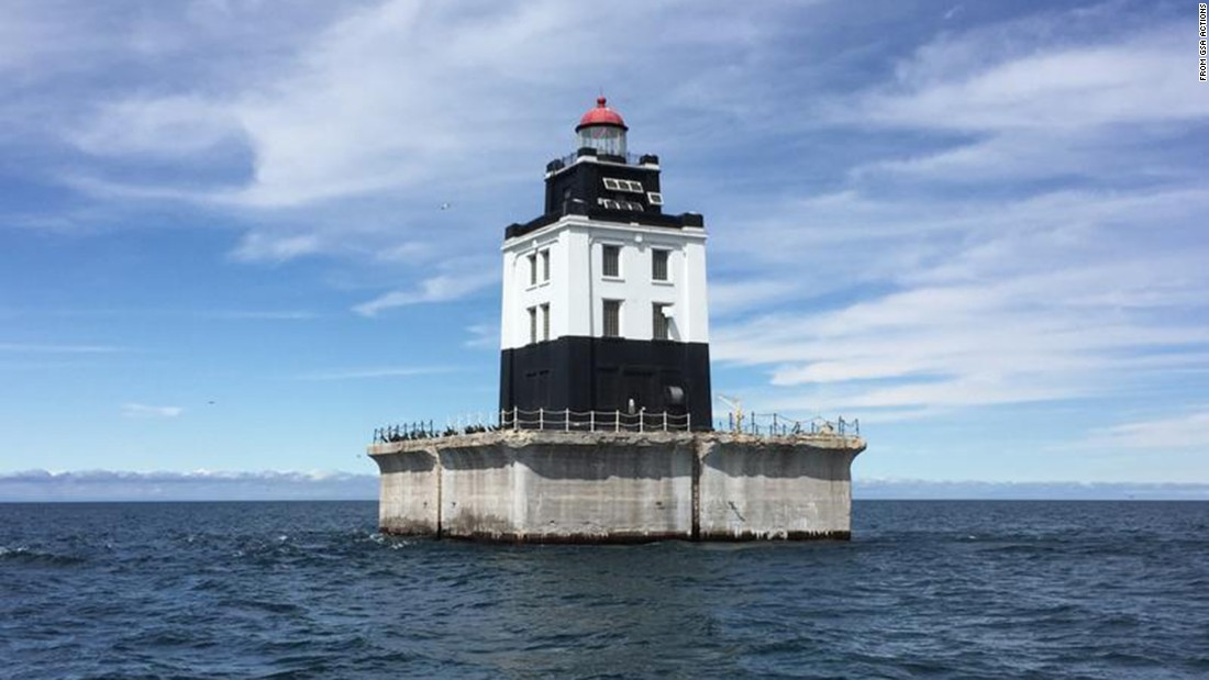 The Poe Reef lighthouse in Cheboygan, Michigan, features a 71-foot-tall square tower on a concrete crib. It is one of six out-of-commission lighthouses that are being auctioned by the US government at an asking price of around $15,000 each.