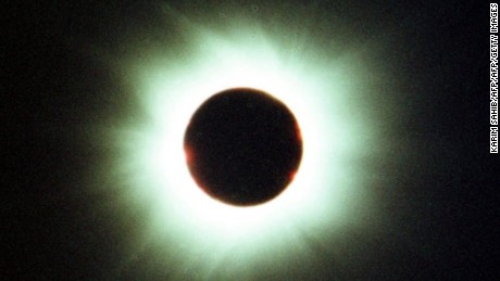 DEIR MATTA, IRAQ:  View of a total eclipse of the sun 11 August 1999 from the monastery site of Deir Matta in northern Iraq. Northern Iraq was bathed in clear skies and sunshine as the shadow swept in for more than two minutes. (Photo credit should read KARIM SAHIB/AFP/Getty Images)