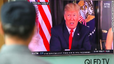 "A man watches a television news programme showing US President Donald Trump at a railway station in Seoul on August 9, 2017. President Donald Trump issued an apocalyptic warning to North Korea on Tuesday, saying it faces ""fire and fury"" over its missile program, after US media reported Pyongyang has successfully miniaturized a nuclear warhead. / AFP PHOTO / JUNG Yeon-Je        (Photo credit should read JUNG YEON-JE/AFP/Getty Images)"