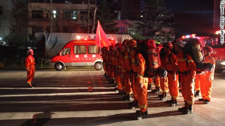 Firefighters in China's Gansu province preparing to head to Sichuan on August 8.
