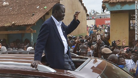 Kenya's opposition alliance, National Super Alliance (NASA) presidential candidte, Raila Odinga arrives at Old-Kibera primary school polling centre to cast his ballots August 8, 2017 mobbed by his supporters in Nairobi. Kenyans began voting in general elections headlined by a too-close-to-call battle between incumbent Uhuru Kenyatta and his rival Raila Odinga that has sent tensions soaring in east Africa's richest economy. / AFP PHOTO / TONY KARUMBA        (Photo credit should read TONY KARUMBA/AFP/Getty Images)