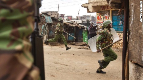 Kenyan security forces chase demonstrators in the Mathare area of Nairobi on Wednesday.
