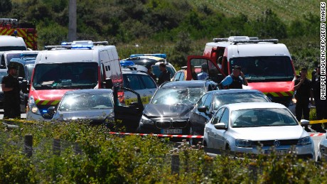 French police and emergency workers intervene on the site after the police arrested a suspect on the A16 motorway, near Marquise.