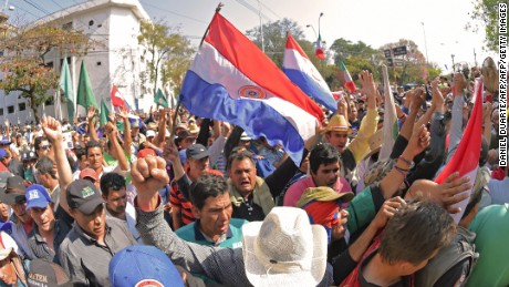 Farmers take part in a protest in downtown Asuncion demanding the writing off of their debts on August 9, 2017.  Farmers are facing economic hardship after failed harvests while Paraguay's President Horacio Cartes has vetoed a law that would forgive their debts. / AFP PHOTO / Daniel DUARTE        (Photo credit should read DANIEL DUARTE/AFP/Getty Images)