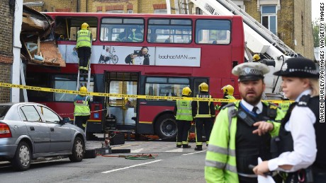 Emergency services at the scene in Lavender Hill, southwest London, after a bus left the road and hit a shop.