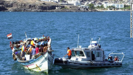 An undated photo shows Yemeni coast guards checking a boat with refugees arriving in Aden.