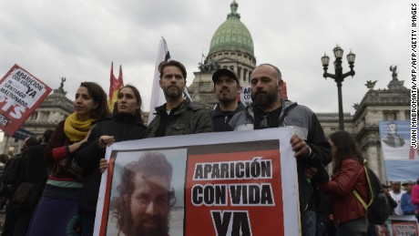 Relatives of disappeared Santiago Maldonado attend a protest in front of the Argentine Congress in Buenos Aires on August 7, 2017.  Social organizations demanded Monday the whereabouts of a youngster who disappeared a week ago when the Gendarmerie dispersed a Mapuche protest in the Pu Lof community, Resistencia, Cushamen department, some 1850 km southwest of Buenos Aires. / AFP PHOTO / JUAN MABROMATA        (Photo credit should read JUAN MABROMATA/AFP/Getty Images)