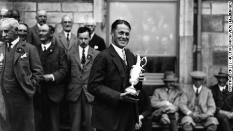 American golfer Bobby Jones (1902 - 1971) holding the trophy after winning the 1927 Open Golf Championship at St Andrews. Jones won the British Open three times (1926, 1927, 1930) and the US Open four times (1923, 1926, 1929, 1930). The Royal and Ancient golf club at St Andrews was founded in 1754 and recognised as the Governing Authority on the rules of the game in 1897. There are now more than 100 countries and associations affiliated to the famous club.   (Photo by Central Press/Getty Images)