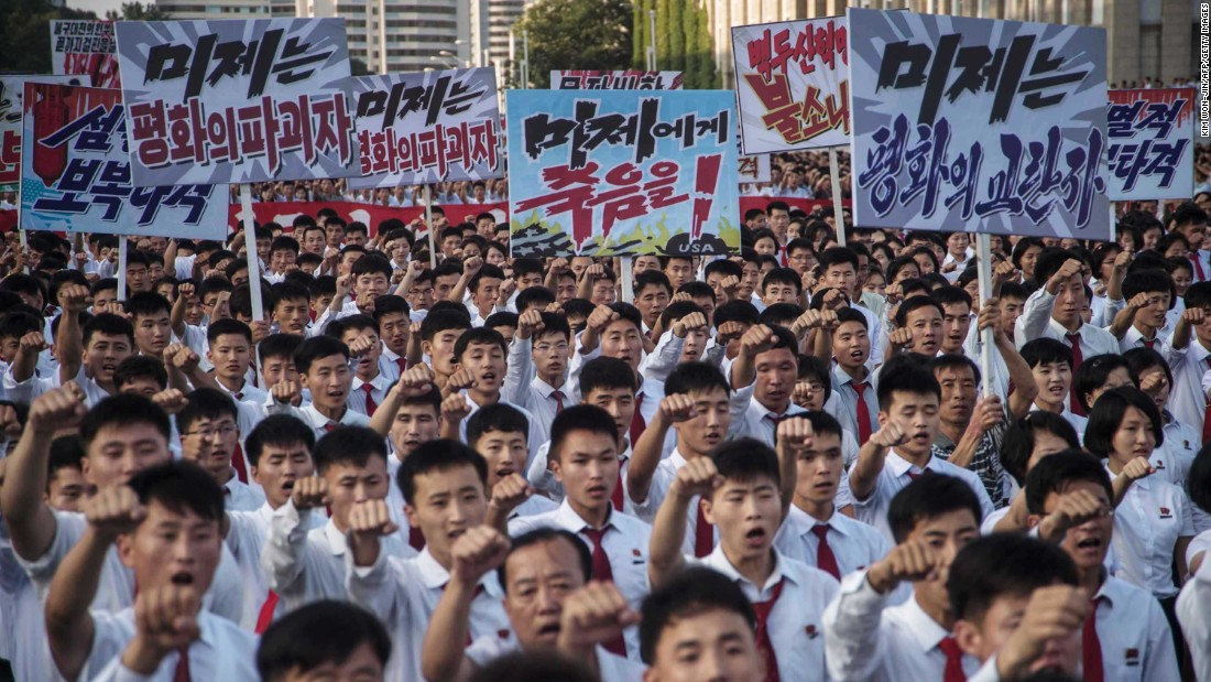 "People carry signs and thrust their fists in the air during the rally. The United Nations Security Council <a href=""http://www.cnn.com/2017/08/05/asia/north-korea-un-sanctions/index.html"" target=""_blank"">recently imposed new sanctions on North Korea</a> for its continued tests of intercontinental ballistic missiles."
