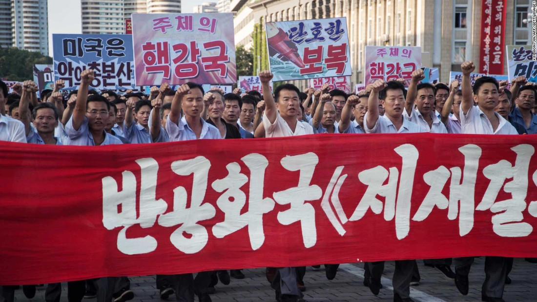 "Demonstrators carry a banner and shout slogans during the rally. <a href=""http://www.cnn.com/2017/08/09/politics/north-korea-considering-near-guam-strike/index.html"" target=""_blank"">A North Korean plan</a> to fire four missiles near the US Pacific territory of Guam will be ready for Kim Jong Un's consideration in days, state media has reported, as <a href=""http://www.cnn.com/2017/08/10/politics/trump-north-korea-threat/index.html"" target=""_blank"">an unprecedented exchange of military threats</a> between Washington and Pyongyang intensifies."