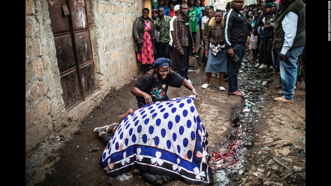 "A woman uses a blanket to cover the body of her dead son Wednesday, August 9, in the slum area of Mathare, which is on the outskirts of Nairobi, Kenya. In the aftermath of the country's presidential election, <a href=""http://www.cnn.com/2017/08/09/africa/kenya-election/index.html"" target=""_blank"">confrontations were reported</a> between police and protesters. Two protesters were shot in Mathare, said two sources who aren't being named for their safety."
