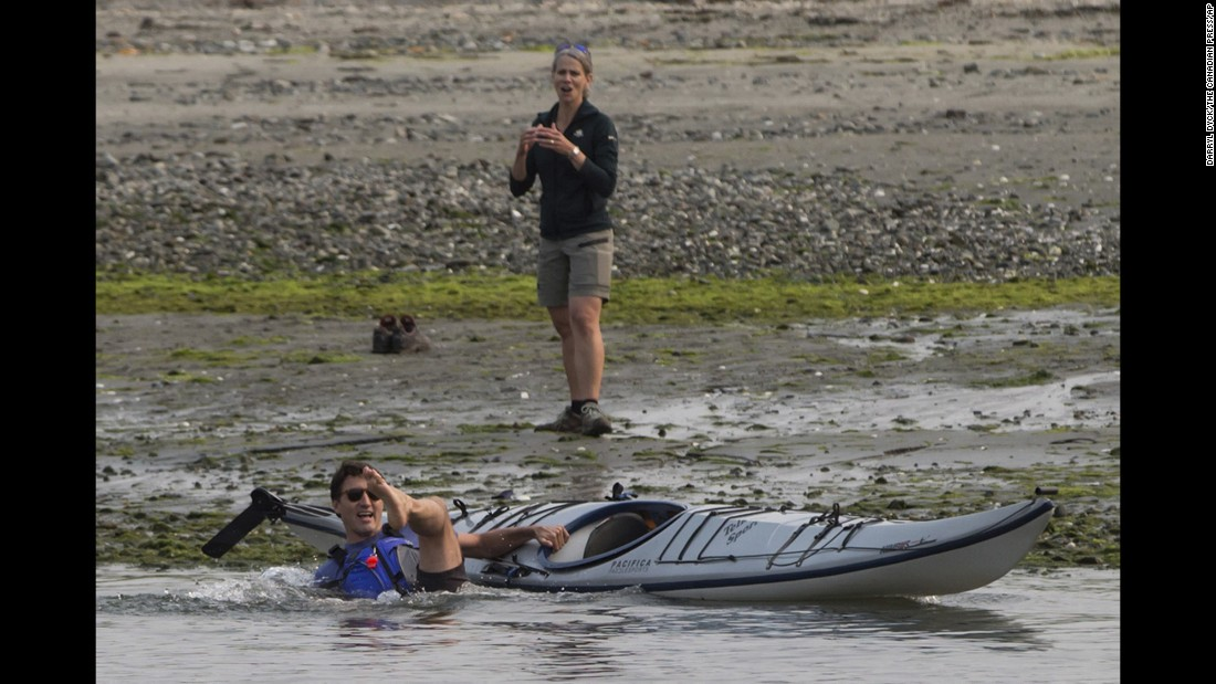 Canadian Prime Minister Justin Trudeau falls into the water as he tries to get into a kayak near Sidney, British Columbia, on Saturday, August 5.