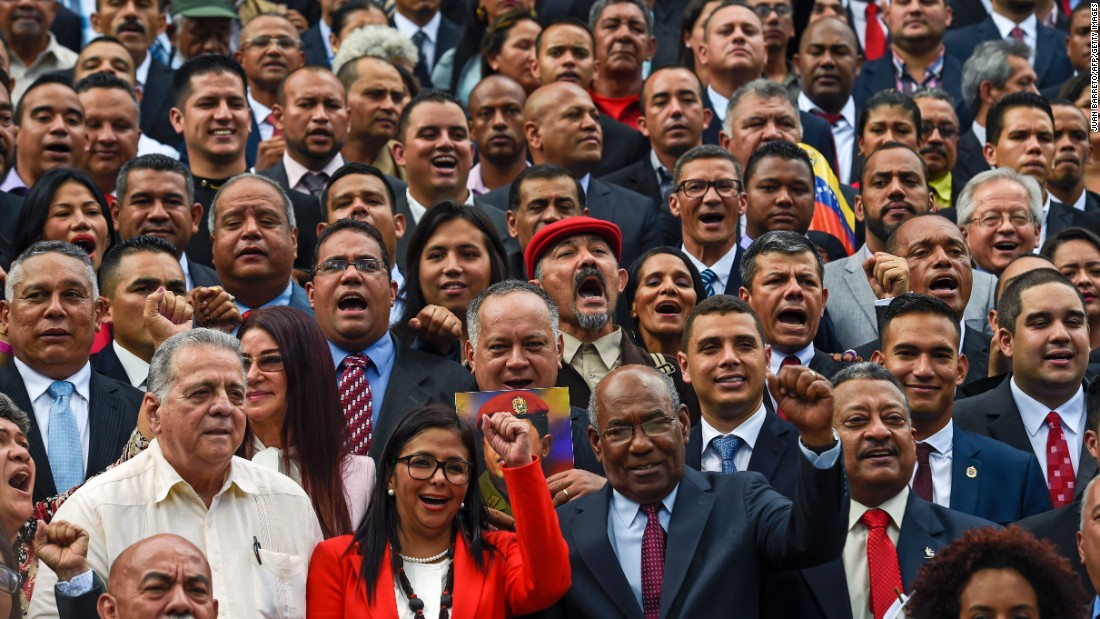 "Members of Venezuela's new Constituent Assembly shout slogans as they pose outside the National Congress in Caracas on Friday, August 4. The new legislature has wide-ranging powers and is expected to rewrite the country's constitution at the behest of President Nicolas Maduro. The group was created in a national vote orchestrated by Maduro and boycotted by his opposition. <a href=""http://www.cnn.com/2017/04/12/world/gallery/venezuela-protests/index.html"" target=""_blank"">See more photos of the crisis in Venezuela</a>"