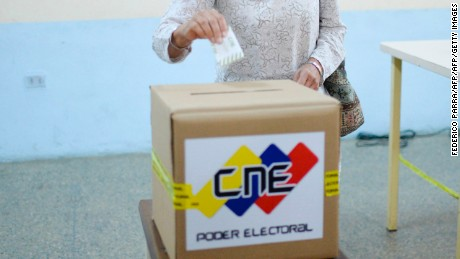 The rector of the National Electoral Council (CNE), Socorro Hernandez, casts her vote in Caracas on July 16, 2017 in a dry-run simulation to elect the members of a citizens' body to redraft the country's basic law proposed by Venezuelan President Nicolas Maduro, which is to be held on July 30, as the opposition holds a symbolic vote to reject Maduro's plans to rewrite the constitution. Authorities have refused to greenlight the vote that has been presented as an act of civil disobedience and supporters of Maduro are boycotting it. Protests against Maduro since April 1 have brought thousands to the streets demanding elections, but has also left 95 people dead, according to an official toll.  / AFP PHOTO / Federico PARRA        (Photo credit should read FEDERICO PARRA/AFP/Getty Images)