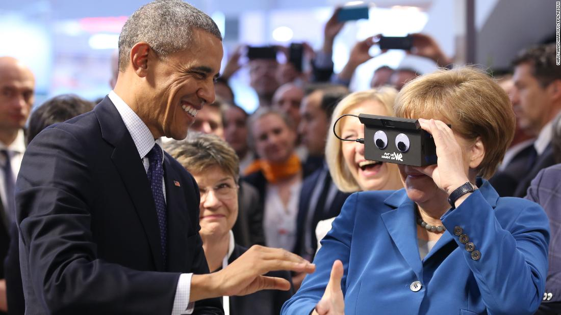 Merkel and Obama test a virtual-reality headset at a trade fair in Hanover, Germany, in April 2016.
