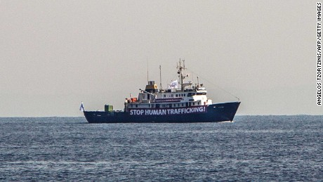 A banner that reads 'Stop Human Trafficking' is attached to the side of the C-Star as it sails in the Mediterranean Sea.