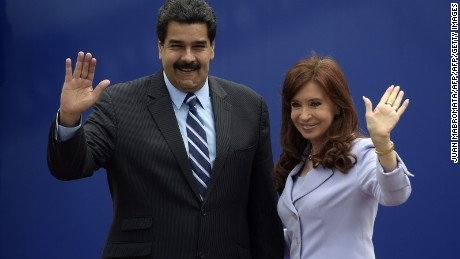 Argentina's President Cristina Fernandez (R) and Venezuela's Nicolas Maduro wave during the 47th Mercosur Summit family photo, in Parana, Entre Rios, Argentina on December 17, 2014. AFP PHOTO / Juan Mabromata        (Photo credit should read JUAN MABROMATA/AFP/Getty Images)