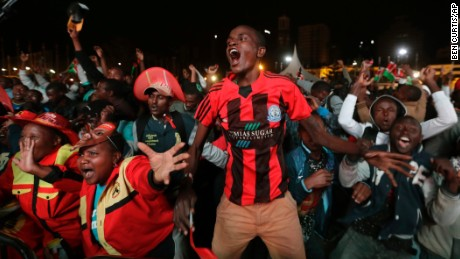 Supporters of Kenya's President Uhuru Kenyatta cheer as they hear the election results.